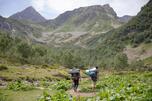 Tourists trekking to the Dukka Lakes in Karachay-Cherkess Republic.