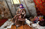 The wife of a reindeer herd in Russian tundra