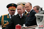 Russian President Vladimir Putin, centre, flanked by Defense Minister Sergei Shoigu, left, and Federal Security Service Chief Alexander Bortnikov CN