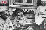 Peasants reading newspaper