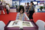 A woman reads a book CN