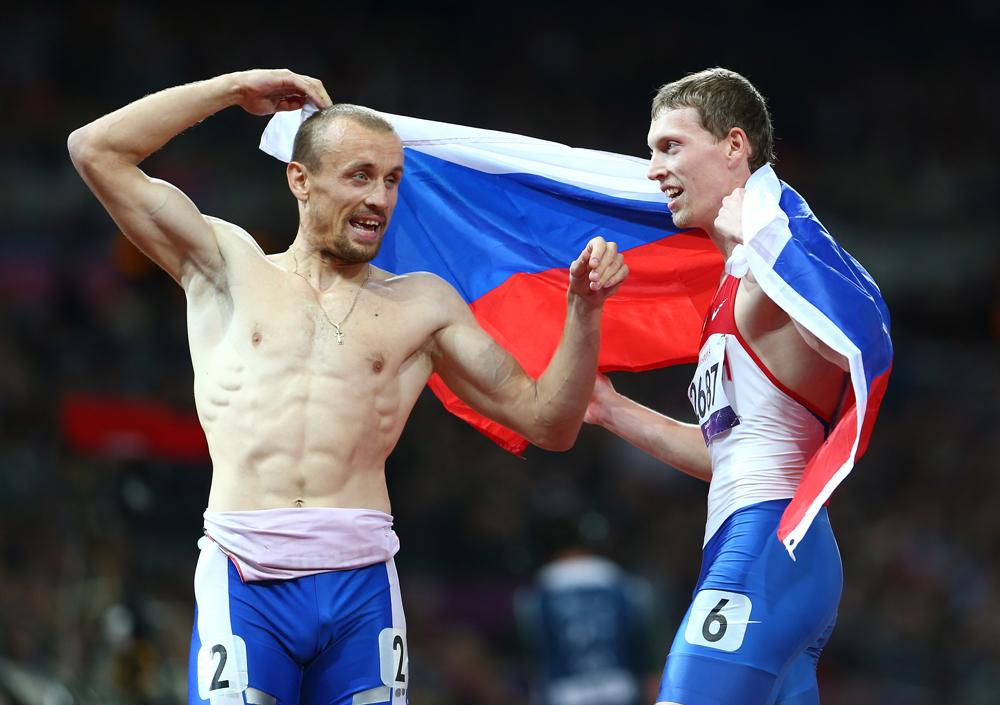 Gold medalist Alexey Labzin of Russia celebrates with silver medalist Alexander Zverev of Russia in the Men's 400m - T13 Final on day 4 of the London 2012 Paralympic Games at Olympic Stadium on September 2, 2012 in London.