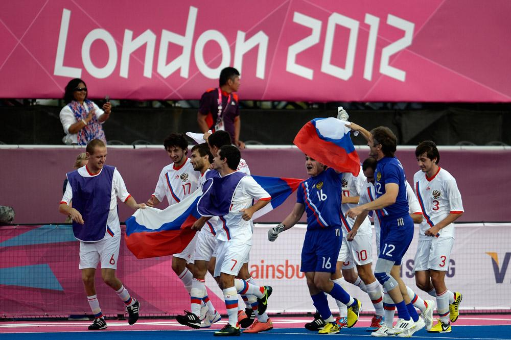 The team of Russia celebrates after winning the gold in the Men's Team Football 7-a-side Gold Medal match against Ukraine on day 11 of the London 2012 Paralympic Games at Olympic Park on September 9, 2012.