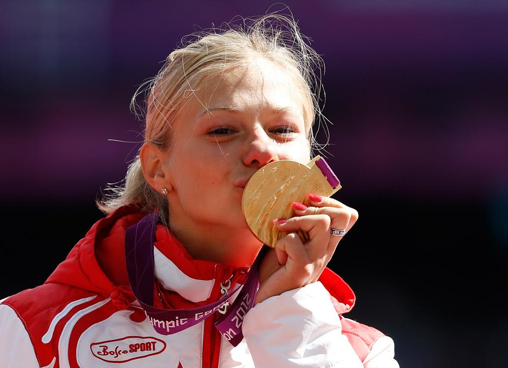 Margarita Goncharova poses with the gold medal after winning the women's long jump-F37/38 athletics event during the London 2012 Paralympic Games at the Olympic Stadium on August 31, 2012.