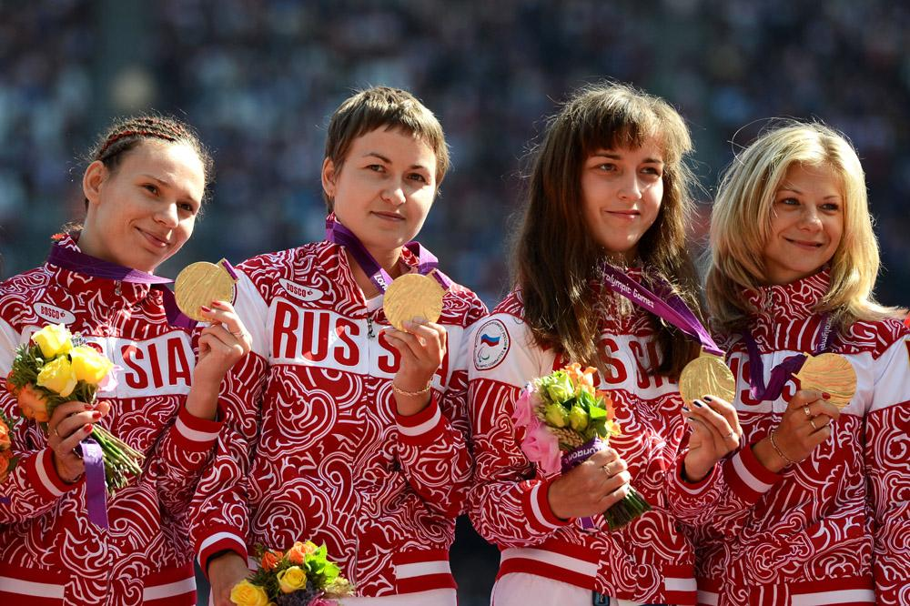 Gold medallists Anastasiya Ovsyannikova, Svetlana Sergeeva, Elena Ivanova and Margarita Goncharova of Russia pose on the podium during the medal ceremony for the Women's 4x100m Relay - T35/T38 Final on day 7 of the London 2012 Paralympic Games at Olympic Stadium on September 5, 2012 in London, England.