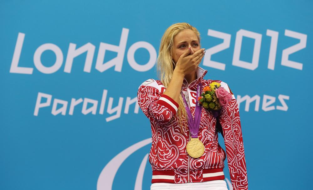 Gold medallist Olesa Vladykinsa of Russia poses on the podium during the medal ceremony for the Women's 100m Breaststroke - SB8 Finalon day 3 of the London 2012 Paralympic Games at Aquatics Centre on September 1, 2012 in London, England.