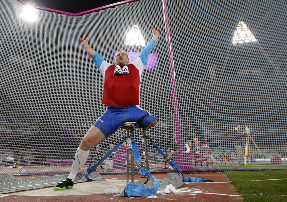 Russia's Alexey Ashapatov celebrates after breaking the world record with this throw and winning the gold medal in the men's discus throw - F57/58 athletics field event during the London 2012 Paralympic Games at the Olympic Stadium in London on August 31, 2012.