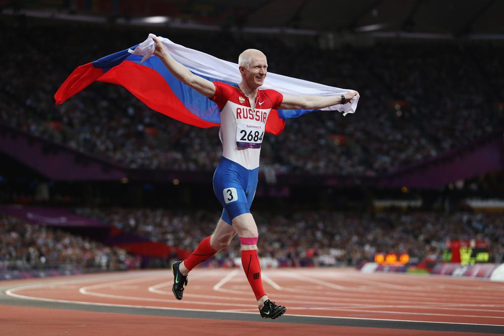 Fedor Trikolich of Russia celebrates winning gold in the Men's 100m - T12 Final on day 6 of the London 2012 Paralympic Games at Olympic Stadium on September 4, 2012 in London.