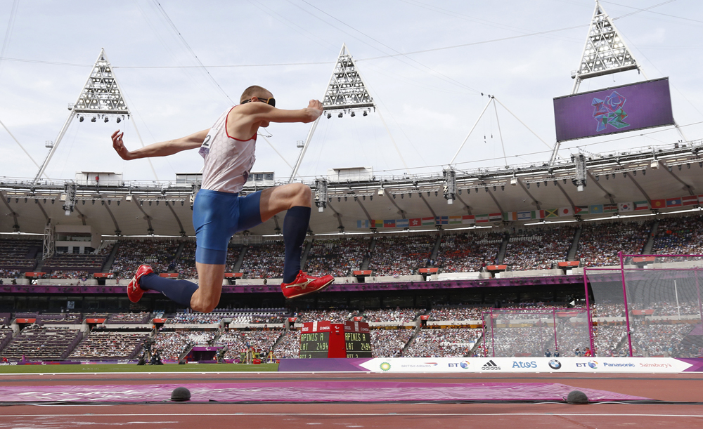Russia's Denis Gulin competes in the men's triple jump - F11 final in the Olympic Stadium at the London 2012 Paralympic Games September 6, 2012. Gulin, who won a gold medal in the final, was competing against other athletes who were also visually impaired.