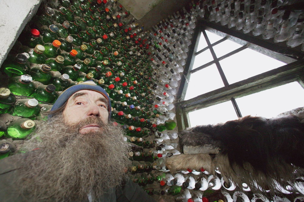 Vladimir Michkov from Kalinigrad presents his room decorated with empty glass bottles.
