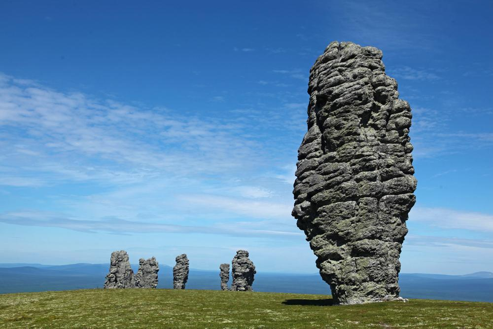 MAN-PUPU-NER PLATEAU. These giant stone statues located on the Man-Pupu-Ner plateau in a remote area of the Northern Urals in the Komi Republic were formed by selective weathering of the surrounding rocks. With a total of seven pillars, each rising 30-40 m high, the Man-Pupu-Ner plateau is a popular site for sports tourism.