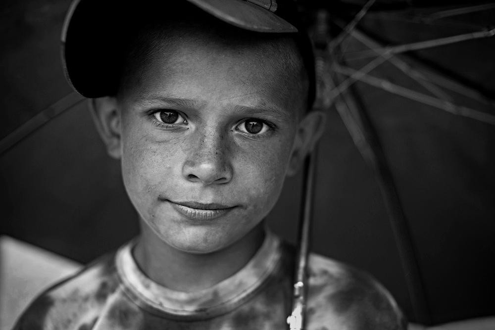 Andrei is nine years old. He lives in the village all year round and nature in summer gives him a chance to earn bit of money.