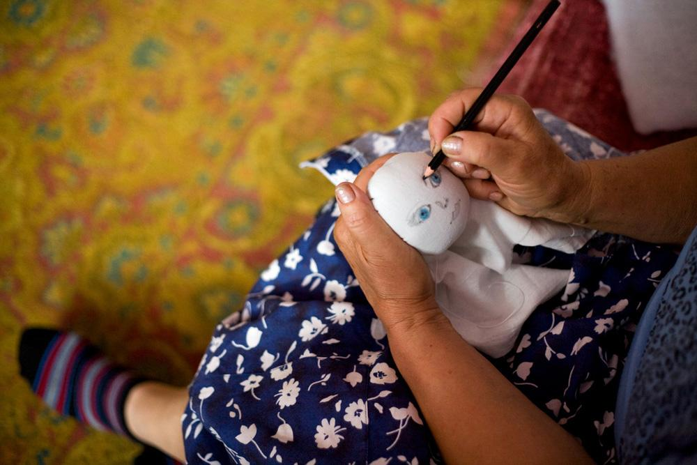 Yekaterina Panarina, 66, started to make dolls after her son has died a few years ago... Mikhaylovka Village, Novosibirsk Region, 2011