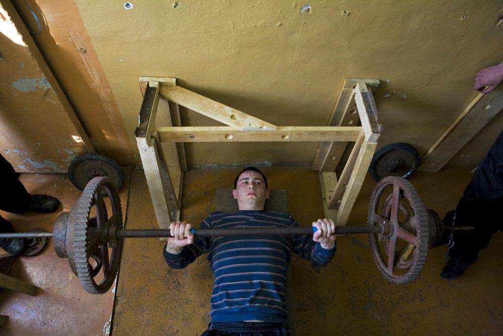 In the Club of Aleksandrovka village teenagers are building bodies with the help of tractor wheels (instead of professional disks). There is a superb gym in the local school but the young athletes still prefer the old Club for bodybuilding. Novosibirsk region, 2010
