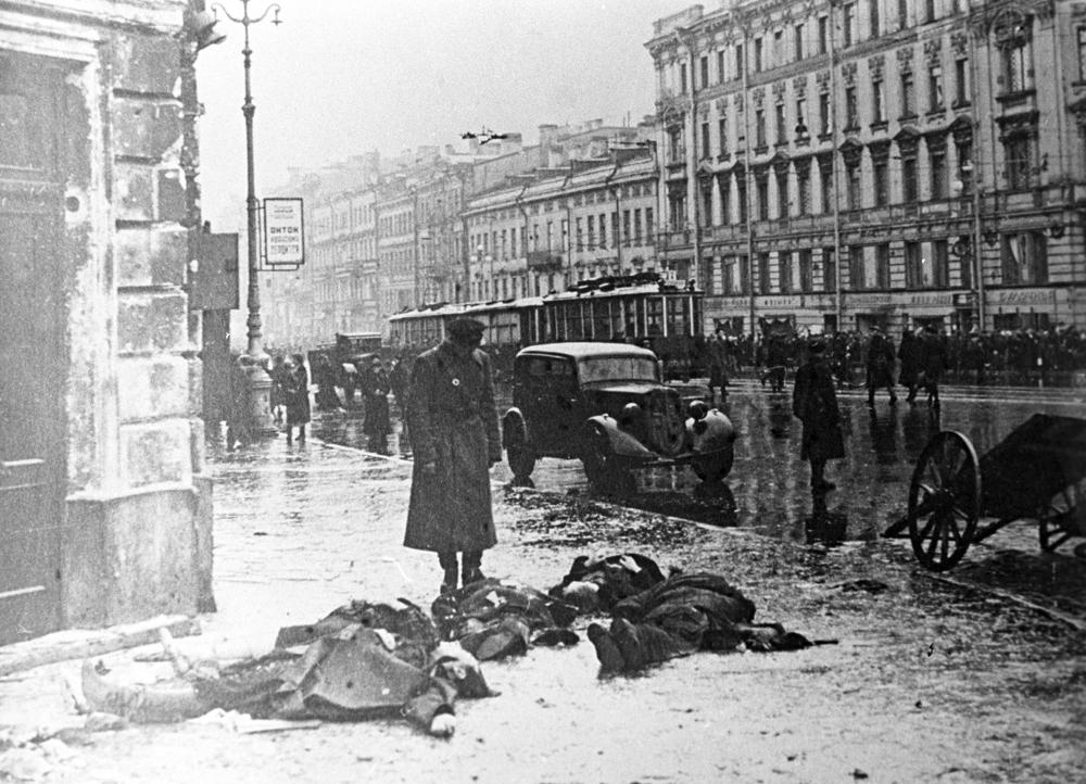 By September 8, 1941 German and Finnish forces had surrounded the city, cutting off all supply routes to Leningrad and its suburbs except the Road of Life across the frozen surface of Lake Ladoga. However the original drive on the city failed and the city was subjected to a siege. // On Nevsky Prospekt after German artillery bombardment. Siege of Leningrad.