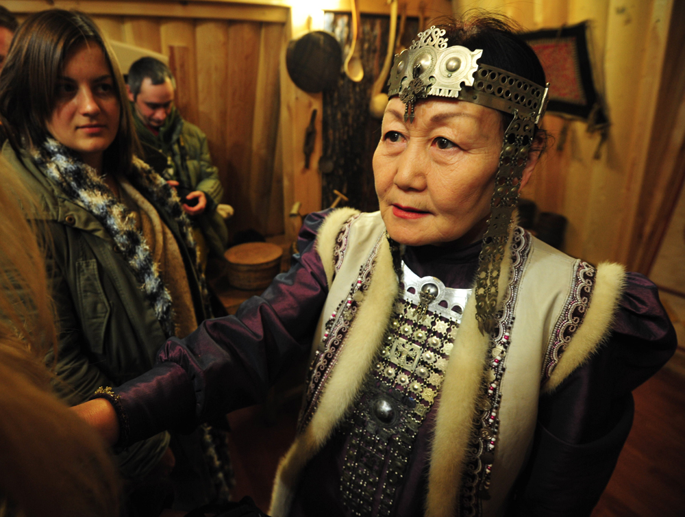 Everyone is wearing traditional costumes. Beautiful woman are draped in silver. On festival days Yakut women decorate themselves with all manner of adornments which in sum may weigh up to 17 kg (7.5 lbs).