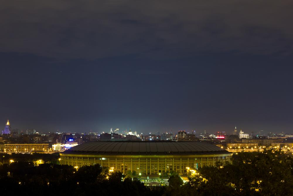 """LUZHNIKI ARENA. Russia's biggest and most famous arena is the Luzhniki in Moscow. Its total seating capacity is 89,318 seats. The stadium is a part of the Luzhniki Olympic Complex, previously called the Central Lenin Stadium. The name Luzhniki derives from the flood meadows in the bend of Moscow River where the stadium was built, translating roughly as """"The Meadows""""."""