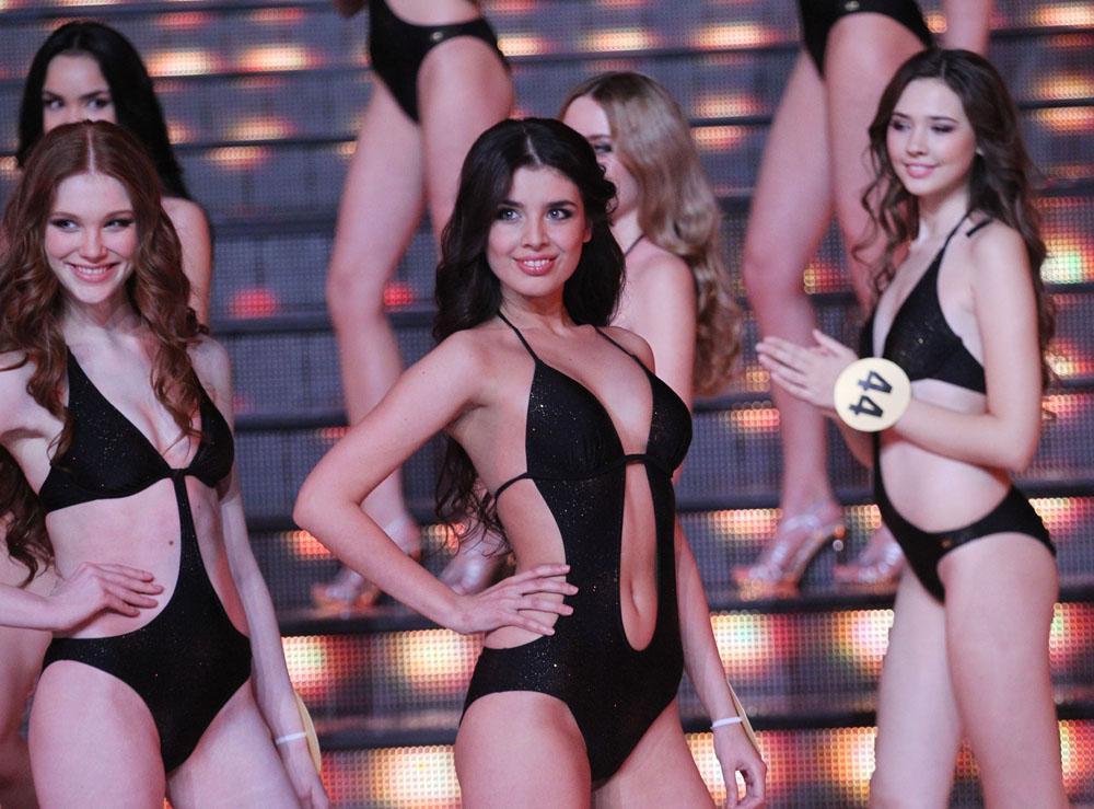 Elmira Abdrazakova (center), an 18-year old student from Siberian town of Mezhdurechensk, was crowned Miss Russia 2013.