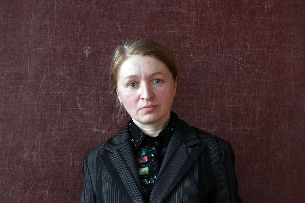 """Maria, 47, is a physics teacher. She lives with her son and has lost faith in ever feeling contented in a relationship. """"All the men in Ivanovo are drunks,"""" she says."""