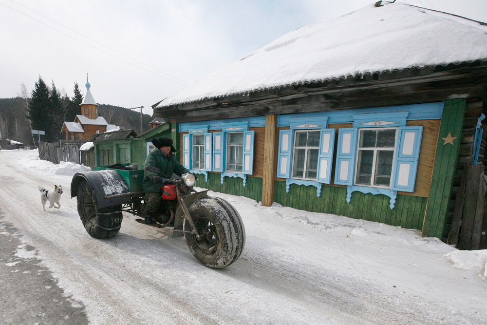"Yushkov created the vehicle for off-road travel across the taiga through all possible weather conditions by modifying and reconstructing a 1971 Soviet made ""Izh Planeta"" motorcycle. Yushkov drives his self-made three-wheeled cross-country vehicle in the village of Ovsyanka."