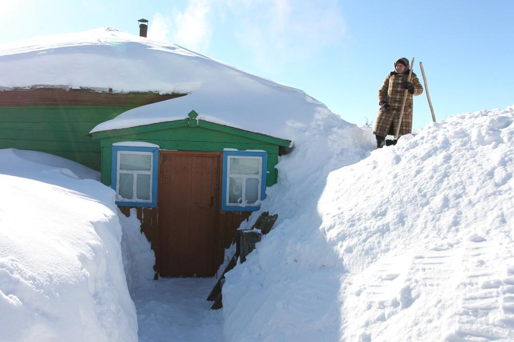 Beshenkevo village in Moscow Oblast looks not unlike any other village in the region these days.  Snow has been falling thick across Russia, raising emergency concerns in many central regions.