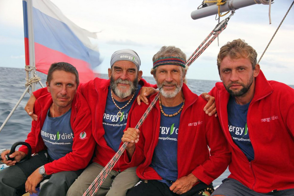 Anatoly Kulik's four-man team has become the first to circumnavigate the globe in an inflatable catamaran. Different people have been on the catamaran over the course of its miraculous journey.