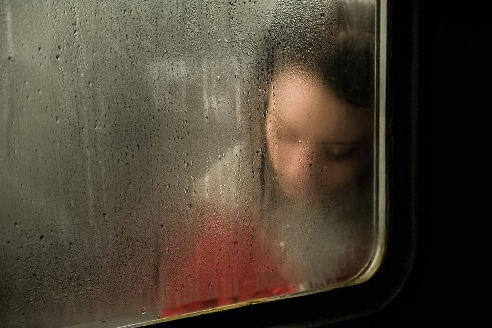 A girl sleeps in a train car. The usual five-day working week is, in fact, an exhausting task. The daily grind of traveling on public transport saps the energy.