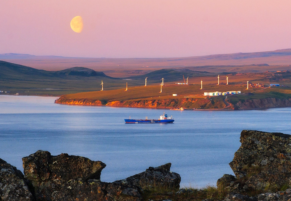 The Chukotka Autonomous Oblast boasts a real Arctic gem called the Wrangel Island Preserve, often referred to as the polar bear 'birthing house'. Wrangel Island is unmatched among other Arctic islands in terms of biodiversity, surpassing the whole of the Canadian Arctic Archipelago. // August moon over the Anadyr Bay and a wind power plant.