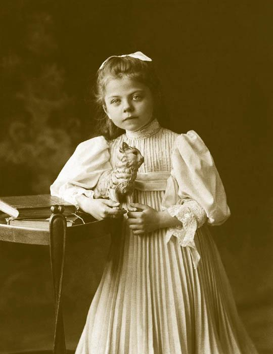 In 1910-1913, the trend for children's fashion to become more adult intensified. Many styles and fabrics in vogue with women became part of the children's wardrobe, too. But World War One saw a lot of belt-tightening, and many were forced to resew and rework children's clothes. Many protests sounded against children's fashion — simplicity was the order of the day. Girls' dresses became knee-length with a low waist, and simple-cut belted trapezoidal dresses and children's sarafans entered into use.