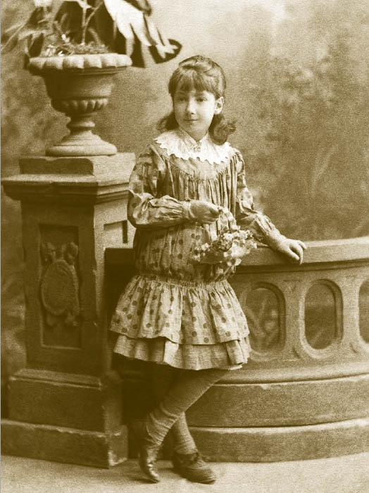 """In the 1880s, children's fashion suddenly broke loose and set the style for trendy adult wear in the 20th century. A great deal of attention was paid to clothing for girls. The most popular was the whole-cut """"princess"""" dress with a lowered waist and accordion-pleated skirt, often trimmed with lace and English embroidery. In this cut, one cannot fail to discern the silhouette of a woman's dress from the 1920s — truncated with a lowered waist."""