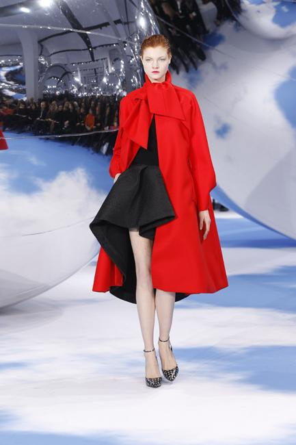 """An """"Arizona 1948"""" coat made of red wool in combination with black cashmere pullover and black silk skirt."""