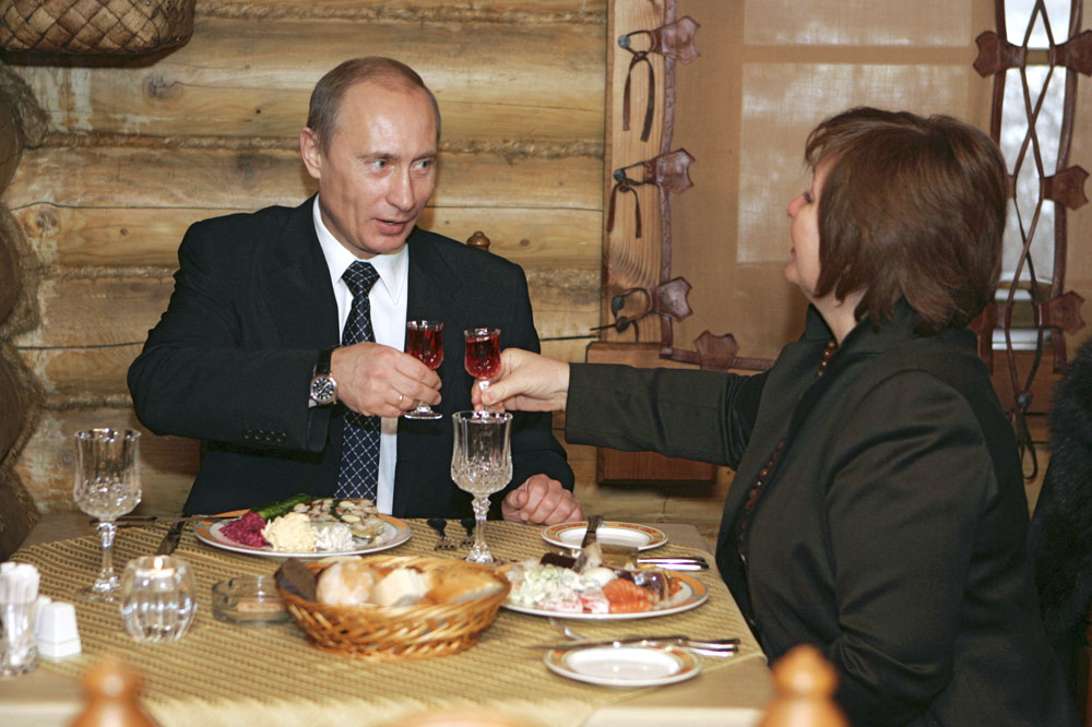 Russia's President Vladimir Putin toasts with his wife Lyudmila as they visit a restaurant in Moscow after voting in elections December 2, 2007. Russians voted on Sunday in a parliamentary election widely viewed as a referendum on Putin and overshadowed by opposition accusations that pro-Kremlin forces enjoy an unfair advantage.