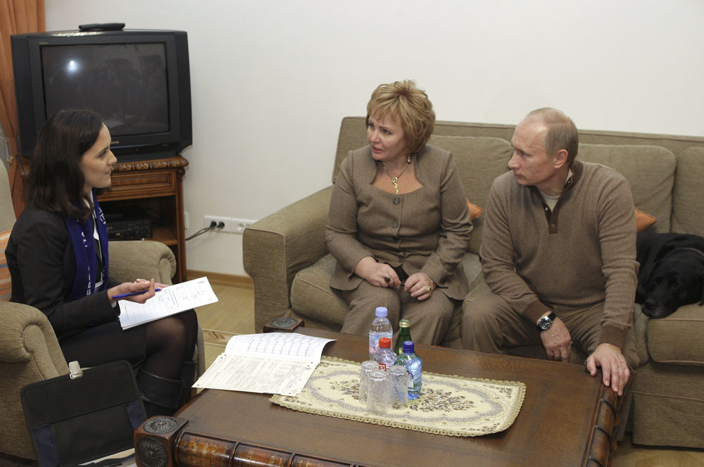 Russia's Prime Minister Vladimir Putin and his wife Lyudmila talk to a census-taker as they participate in a nationwide population count at the Novo-Ogaryovo residence outside Moscow October 16, 2010. Putin and his wife Lyudmila made a rare joint public appearance over the weekend seeking to reaffirm their marriage amid persistent divorce rumours.
