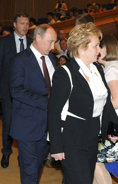 """Russia's President Vladimir Putin and his ex-wife Lyudmila walk before watching the """"Esmeralda"""" ballet at the State Kremlin Palace in Moscow, June 6, 2013. Putin and his wife, Lyudmila, said on state television on Thursday that they had separated and their marriage was over after 30 years."""