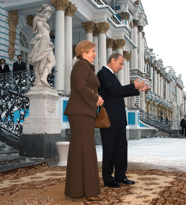Russian President Vladimir Putin and his wife Lyudmila welcome President Bush and his wife Laura, on the steps of Catherine Palace in Pushkin outside St. Petersburg, Russia, Friday, Nov. 22, 2002. Bush came in St. Petersburg from a historic NATO summit in Prague one day after the alliance agreed to expand its membership into the territory of the former Soviet Union.