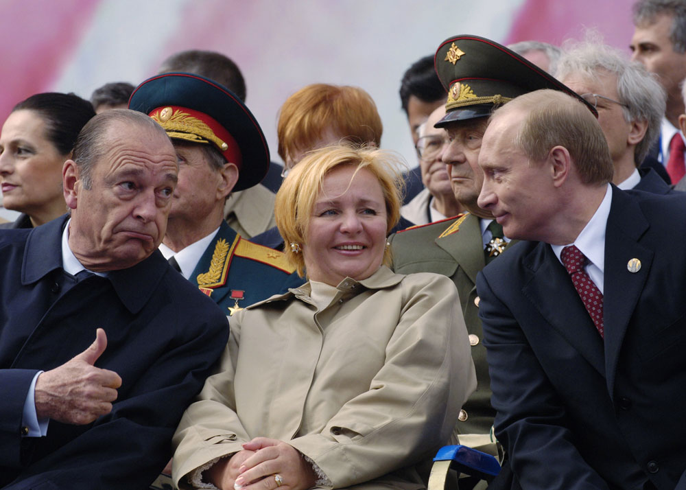 French President Jacques Chirac, left, gives the thumbs up to Russian President Vladimir Putin while Putin's wife Lyudmila smiles during a parade marking the 60th anniversary of the Allied victory over Nazi Germany at the Red Square in Moscow on Monday, May 9, 2005.