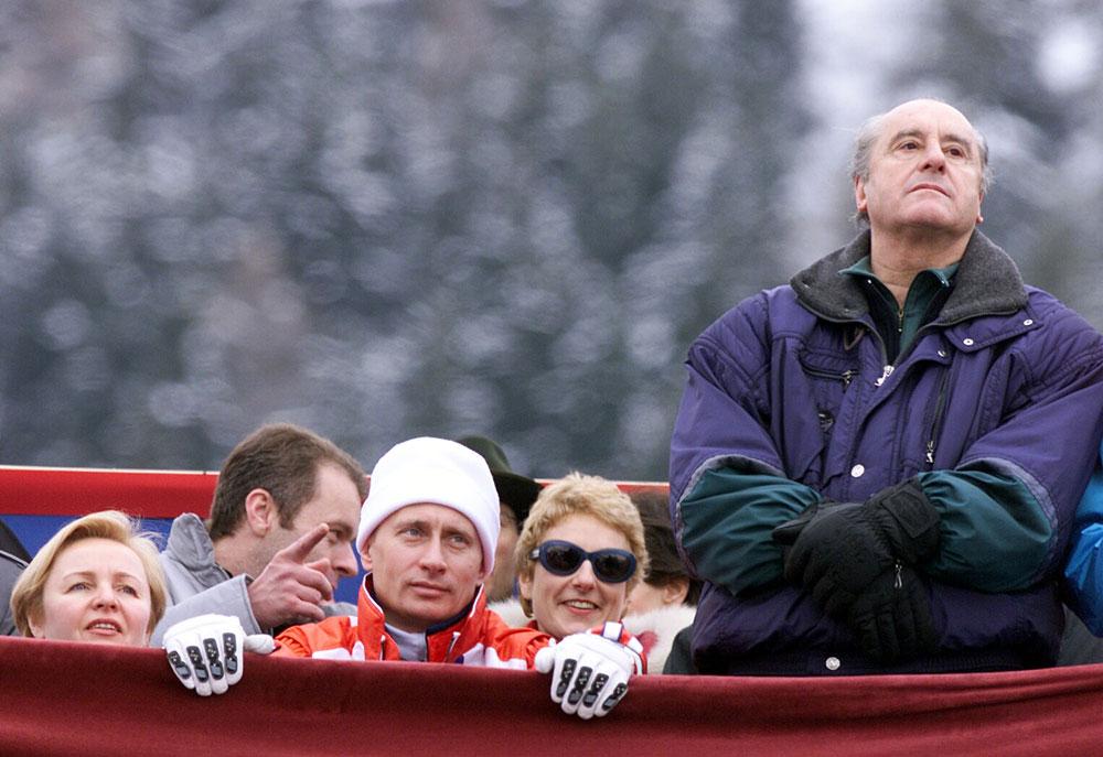 Russian President Vladimir Putin, center, his wife Lyudmila, left, and Austrian President Thomas Klestil watch the men's slalom at the World Alpine Ski Championships in St. Anton, Austria Saturday Feb. 10, 2001