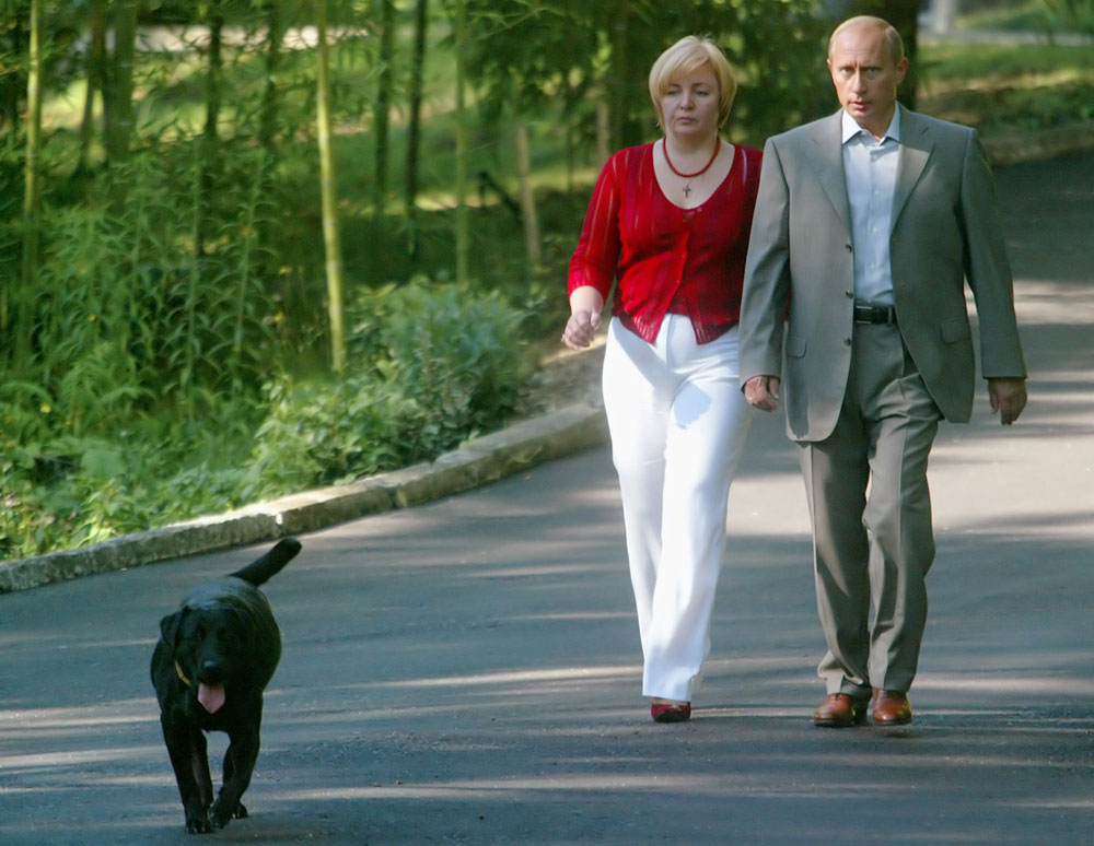 Russian President Vladimir Putin and his wife Lyudmila, walk preceded by their Labrador, Koney, at Putin's residence in the Russian Black Sea resort of Sochi, in this Sept. 14 , 2003 photo. The dog just had puppies.