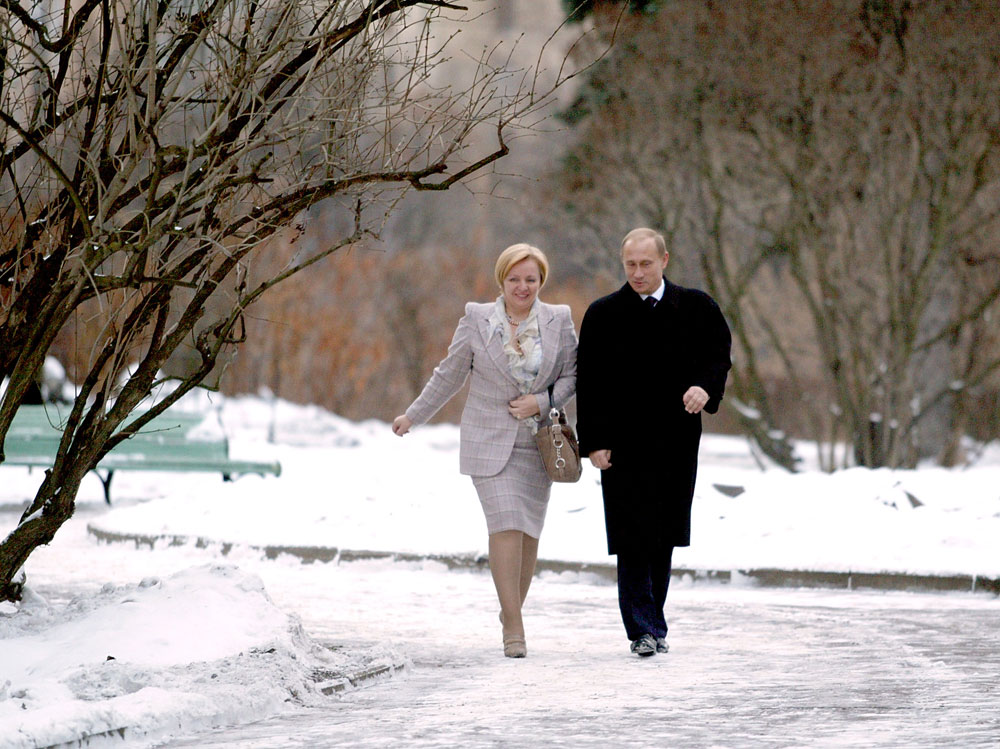 Russian President Vladimir Putin and his wife Lyudmila approach the polling station in Moscow, December 7, 2003. Russians voted on Sunday in parliamentary polls expected to tighten Putin's grip on power andopen the way for economic reform.