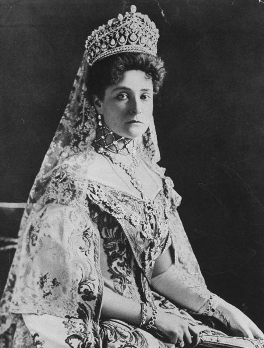 "Empress Alexandra Fedorovna (aged 46 on the day she was shot) // ""Tall, with thick golden hair down to her knees, she was constantly blushing with shyness, like a young girl; her eyes, huge and profound, came alive when she was in conversation, and they laughed. At home she was known as Zippu, and her husband always called her Sunny."" (From the memoirs of A. Vyrubova, lady in waiting to the tsarina)"