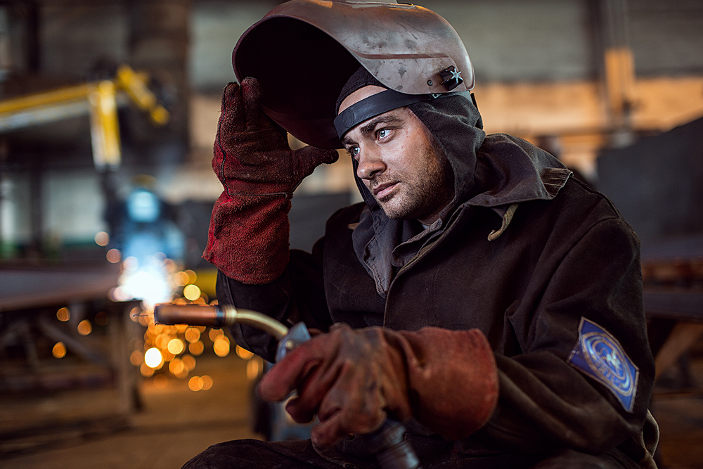 Welders are also subjected to the daily risk of receiving a shock, ruining their sight, and damaging their lungs and hearing. In the photo: a welder. Omsk, located in southwestern Siberia 2,236 kilometers from Moscow.