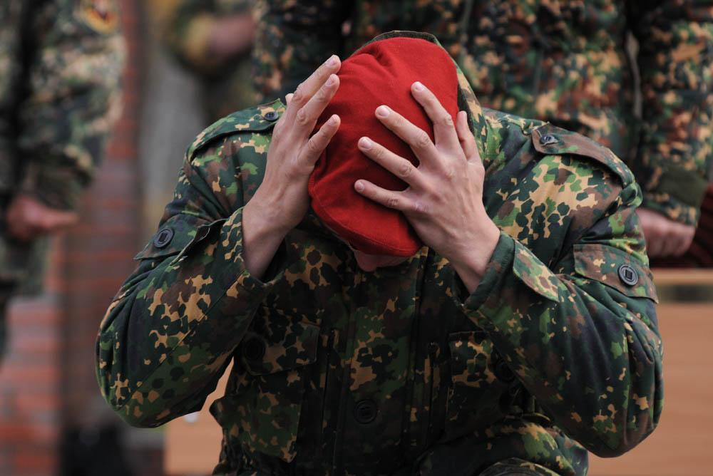 The maroon beret is a shaped hat that troops and service members of internal Special Forces units wear.