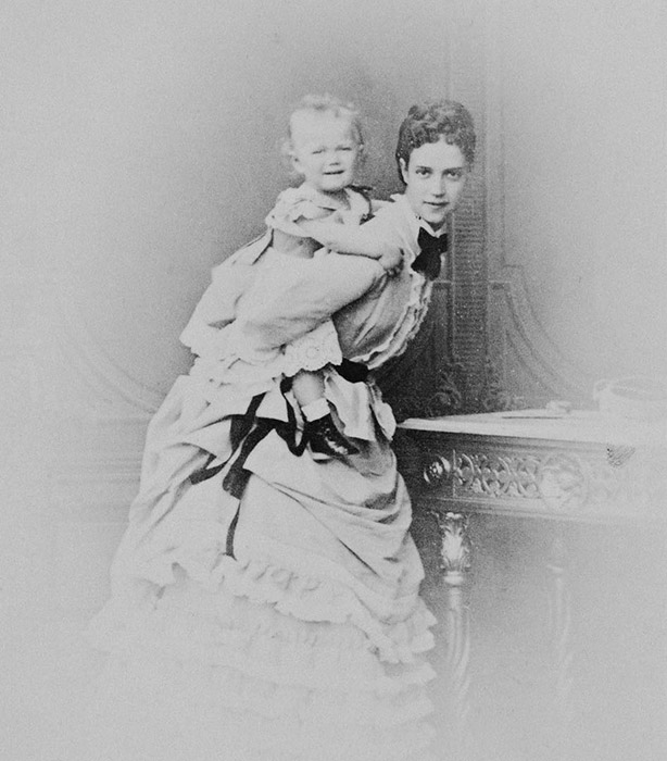 Maria Fyodorovna and Alexander III had a total of 6 children: their oldest son, Nikolai; Alexander, Grigory, Ksenia, Mikhail, and their youngest child, Olga. / Maria Fyodorovna with her son, Nikolai, who would become the last Romanov emperor