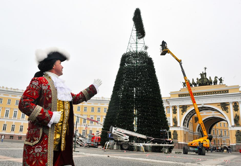 Setting up the Christmas tree on Palace Square in Saint Petersburg. In the picture: a man in a historic costume from the time of Peter the Great.