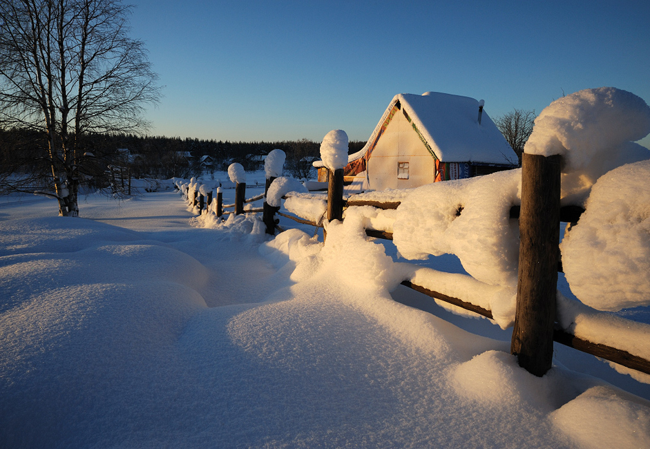 Snow buries Nilmoguba's wooden houses in the winter, and sedge and tall weeds grow in the summer.