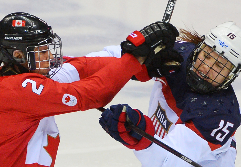 From left: Meghan Agosta (Canada) and Anne Schleper (United States) during the finals between the US and Canadian national teams in the women's ice hockey tournament.