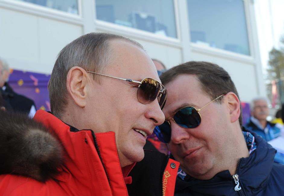 Russian President Vladimir Putin, left, and Russian Prime Minister Dmitry Medvedev attend the men's cross country skiing relay of the Olympic Games in Sochi, at the Laura Cross-Сountry Ski & Biathlon Center.