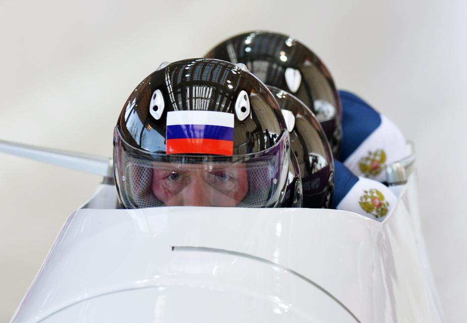Alexander Zubkov, Alexei Voevoda, Alexei Negodaylo and Dmitry Trunenkov (Russia) at the start of the third heat of the four man bobsleigh competition.