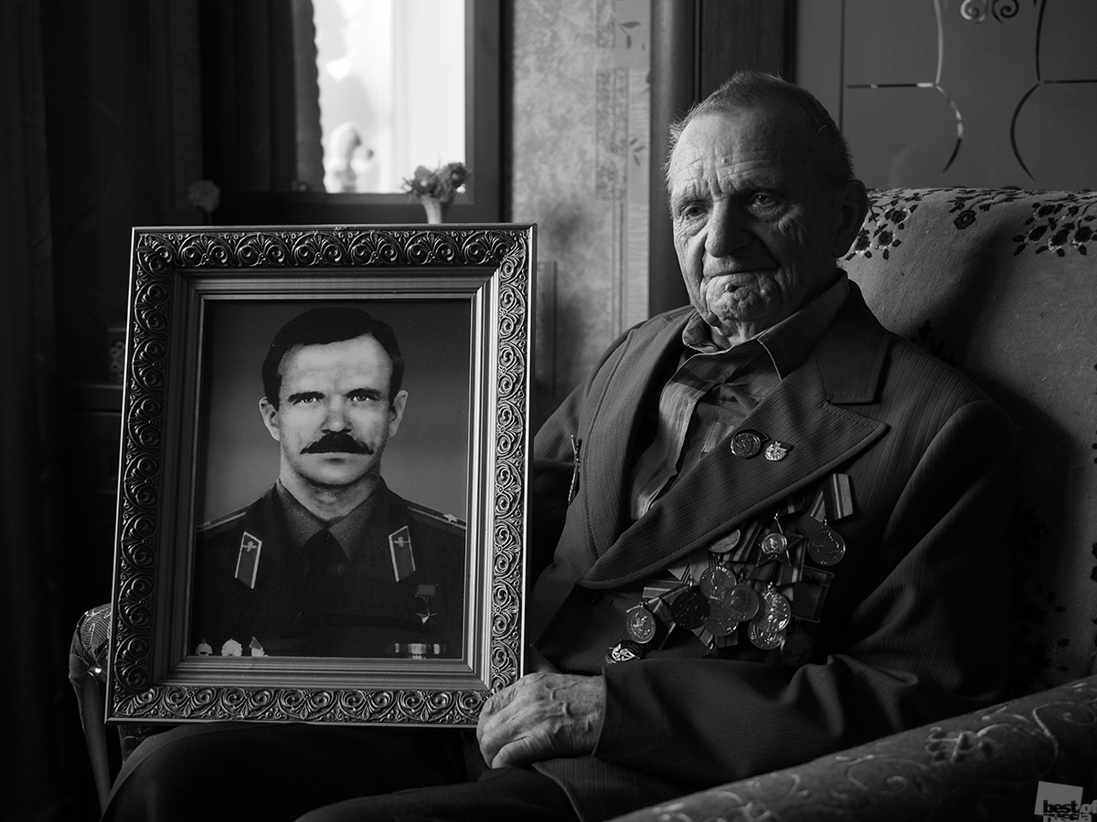 You have to let go of your past, no matter how hard it was. // A veteran of the Great Patriotic War with a portrait of his son, a hero of the Soviet Union, who died in Afghanistan in 1989.