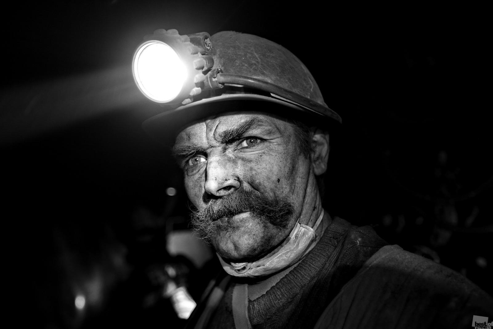 A third group are so engrossed in work that they don't see the light of day // A drift miner at the preliminary coal-face. Leninsk-Kuznetsk, Kemerovo region